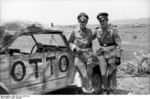 Hans-Joachim Marseille and another pilot posing next to a Kübelwagen vehicle, Libya, summer 1942