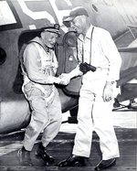 US Navy Captain Harold Martin greeting VAdm John McCain, Sr. after a trap landing aboard light carrier San Jacinto, late 1944; seen on page 113 of US Navy War Photographs