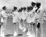 Clarence McClusky receiving the Distinguished Flying Cross award from Admiral Chester Nimitz, onboard carrier Enterprise, Pearl Harbor, US Territory of Hawaii, 27 May 1942; note Doris Miller in foregr