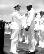 Doris Miller receiving the Navy Cross award from Admiral Chester Nimitz, onboard carrier Enterprise, Pearl Harbor, US Territory of Hawaii, 27 May 1942; photo 2 of 2