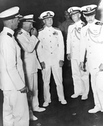 Admiral Mitscher and Commodore Burke aboard USS Franklin D. Roosevelt, 7 May 1946; other officers were Captain Thomas Regan, Vice Admiral Bernhard Bieri, and Lieutenant Commander Remington