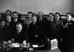 Soviet Foreign Minister Molotov signing the Soviet-Japanese Neutrality Pact, 13 Apr 1941; note Matsuoka and Stalin in background