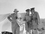 Winston Churchill, Leslie Morshead, Claude Auchinleck, and W. H. C. Ramsden (background) at 9th Australian Division headquarters, El Alamein, Egypt, 5 Aug 1942