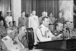 Louis Mountbatten reading surrender terms to Japanese representatives at the surrender ceremony at Municipal Building, Singapore, 12 Sep 1945