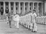 Louis Mountbatten inspecting British Royal Navy Guard of Honour outside the Minicipal Building, Singapore prior to the surrender ceremony, 12 Sep 1945