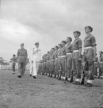Louis Mountbatten inspecting men of British Royal Air Force Regiment outside the Municipal Building, Singapore prior to the surrender ceremony, 12 Sep 1945