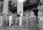 Supreme Allied Commander South East Asia Admiral Lord Louis Mountbatten delivering an address at the Municipal Building, Singapore, 12 Sep 1945, photo 2 of 2; note William Slim, Raymond Wheeler, and Keith Park