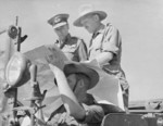 Louis Mountbatten studying a map near Mandalay, Burma aboard a WC command car, 13-18 Jan 1945