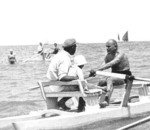 Benito Mussolini rowing a boat with lifeguard Pasquale Corazza and his son Romano Mussolini, Riccione, Italy, 1932