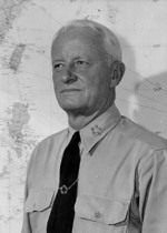 Portrait of US Navy Fleet Admiral Chester Nimitz at his office in Guam, Mariana Islands, circa 16-19 Dec 1944; note five-star tie clasp, which was a gift to him