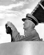 Fleet Admiral Chester Nimitz watching an anti-submarine weapons demonstration aboard destroyer USS Wiltsie in the Atlantic Ocean, 11 May 1946