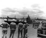 US Navy Adms R. English & C. Nimitz at Pearl Harbor, Hawaii, United States as USS Trout returned with 2 POWs from the sunken Japanese cruiser Mikuma, 14 Jun 1942