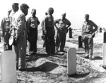 Admiral Chester Nimitz at the US Marine Corps cemetary on Namur Island, Kwajalein Atoll, 6 Feb 1944; also present were USMC Colonel Franklin Hart and Major General Harry Schmidt (with dark glasses)