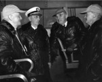 Fleet Admiral Nimitz, Fleet Admiral Leahy, President Truman, and Vice Admiral Mitscher aboard USS Franklin D. Roosevelt during maneuvers off the Virginia Capes, United States, 24 Apr 1946