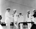 Admiral Nimitz presenting the Navy Cross award to Aviation Machinist
