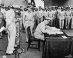 Nimitz signing the instrument of surrender, Tokyo Bay, Japan, 2 Sep 1945, photo 2 of 2