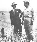 Oppenheimer and Groves immediately after Operation Trinity, circa Aug 1945, photo 1 of 2