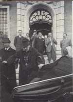 German President Hindenburg getting into his car with help from his son Oskar, 1934; note Papen in background