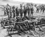 Dwight Eisenhower and other officers inspecting the remains of a German attempt to destroy the remains of dead Jewish prisoners at Ohrdruf Concentration Camp, Gotha, Germany, 12 Apr 1945