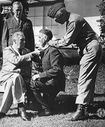 Franklin Roosevelt awarding Brigadier General William Wilbur the Medal of Honor, Casablanca, French Morocco, 22 Jan 1943; note George Marshall in background and George Patton assisting. Photo 1 of 2.