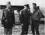 "Generals George Patton, Henry ""Hap"" Arnold, and Mark Clark at the Castelvetrano Airfield, Sicily, Italy, awaiting the arrival of President Roosevelt, 8 Dec 1943."