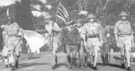 British Army Lieutenant General Arthur Percival and his party carrying the United Kingdom flag on their way to surrender Singapore to the Japanese, 15 Feb 1942, photo 2 of 2