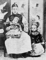 Prince Chun (seated), Xuantong Emperor (standing), and Prince Pujie (in lap), Beijing, China, circa 1909
