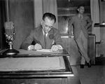 Manuel Quezon giving a radio address regarding woman suffrage and speeding up the Philippine independence timeline, Washington DC, United States, 5 Apr 1937, photo 1 of 2