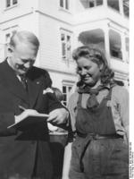 A Norwegian female worker receiving Minister President Vidkun Quisling