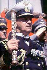 German Navy Grand Admiral Raeder holding his baton at a rally, date unknown