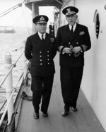 Royal Navy Admiral Sir Bertram Ramsay, Naval commander of the Normandy operations, and US Navy Rear Admiral John L. Hall, Jr., commander of amphibious operations, aboard AGC-4 USS Ancon, 25 May 1944, the day King George VI visited the ship