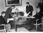 German Foreign Minister Joachim von Ribbentrop signing non-aggression treaties with his Latvian and Estonian counterparts Vilhelms Munters and Karl Selter, Berlin, Germany, 7 Jun 1939