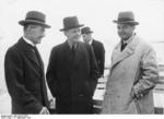 British Prime Minister Neville Chamberlain, German Foreign Minister Joachim von Ribbentrop, and British journalist Ward Price at Lake Chiemsee, Germany, 16 Sep 1938; note British Ambassador to Berlin Nevile Henderson in background