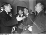 British Ambassador to Berlin Nevile Henderson speaking to German Foreign Minister Joachim von Ribbentrop at the Grand Hotel at Berchtesgaden, Germany, 15 Sep 1938; note British Prime Minister Neville Chamberlain in background