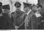 Philippe P�tain and Adolf Hitler, Montoire-sur-le-Loir, France, 24 Oct 1940; note Paul Schmidt and Joachim von Ribbentrop in background