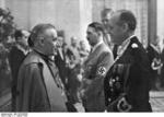 Vatican Apostolic Nuncio to Germany Cesare Orsenigo speaking with Joachim von Ribbentrop, Berlin, Germany, 12 Jan 1939; note Adolf Hitler in background