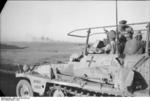 Erwin Rommel observing the field from his SdKfz. 250/3 command vehicle