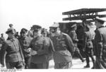Kranke, Buhle, and Rommel speaking after a weapons demonstration, Northern France, 30 May 1944, photo 2 of 2