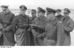 German Army Captain Lang, Field Marshal Erwin Rommel, Lieutenant General Felix Schwalbe, and General Walter Fischer von Weikersthal at the Somme estuary, France, 11 Mar 1944