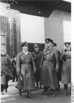 Field Marshal Erwin Rommel and Vice Admiral Friedrich Oskar Ruge touring a submarine pen on the Atlantic coast, France, 12 Feb 1944
