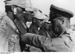 Erwin Rommel awarding the Iron Cross to a man under his command, North Africa, Aug 1942