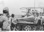 Erwin Rommel speaking to soldiers from his SdKfz. 250/3 vehicle