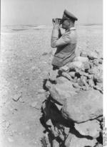 Colonel General Erwin Rommel observing the field with binoculars, North Africa, 1942, photo 1 of 2