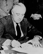 Franklin Roosevelt signing the Declaration of War against Japan, 8 Dec 1941