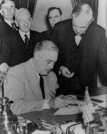 Franklin Roosevelt signing the Declaration of War against Germany, 11 Dec 1941; Senator Tom Connally at right marked the exact time of declaration. Photo 1 of 2.