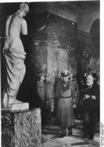Curator of the Louvre Fernand Merlin giving German Field Marshal Gerd von Rundstedt a tour of the museum, Paris, France, Oct 1940; note Venus de Milo status in foreground