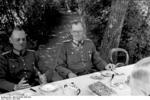 German Army Generals Gerd von Rundstedt and Maximilian von Weichs having a meal with other officers in a garden, France, Jun 1940