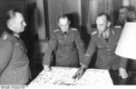 Erwin Rommel and Gerd von Rundstedt in discussion at the Hotel George V, Paris, France, 19 Dec 1943, photo 5 of 5; General Alfred Gause at right of photo