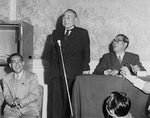 Construction Minister Eisaku Sato, Prime Minister Shigeru Yoshida, and Party Chairman Saeki Ozawa at a Liberal Party meeting in Japan, 1953