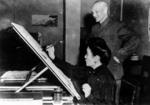 Chiang Kaishek observing Song Meiling practicing calligraphy, date unknown